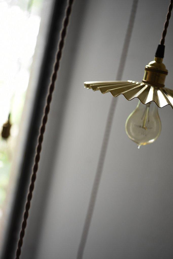 Brushed brass fluted pendant light